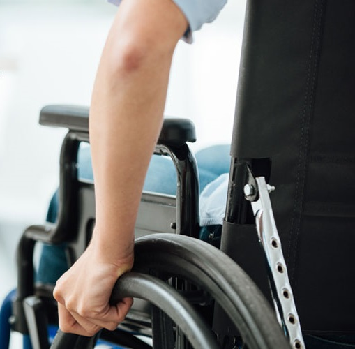 View of a person in a wheelchair from behind